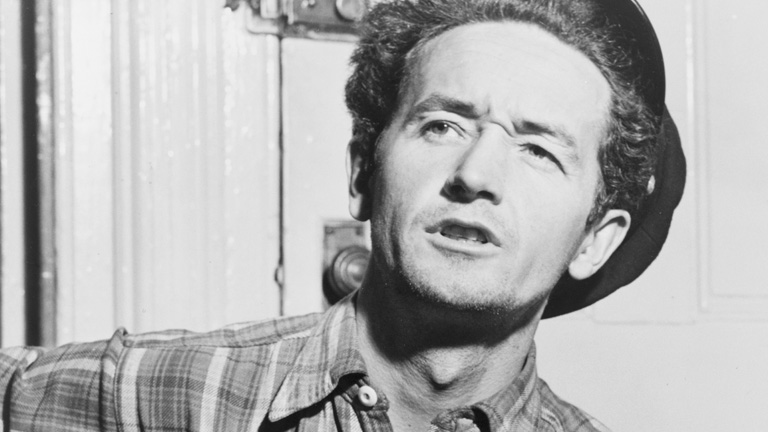 the life and music of woody guthrie an american singer songwriter Woody guthrie 1912-1967: singer-songwriter we complete our story about songwriter and singer woody guthrie the life, music and politics of woody guthrie.
