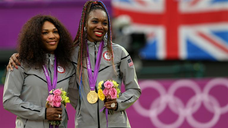 The Williams sisters pose with their gold medals